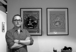Matthew Fargher at home in front of his Shepard Fairey prints. Image: © Florence Early