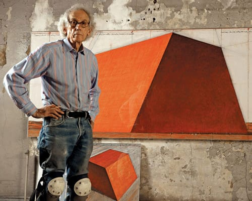 Christo in front of his plans for his Mastaba project